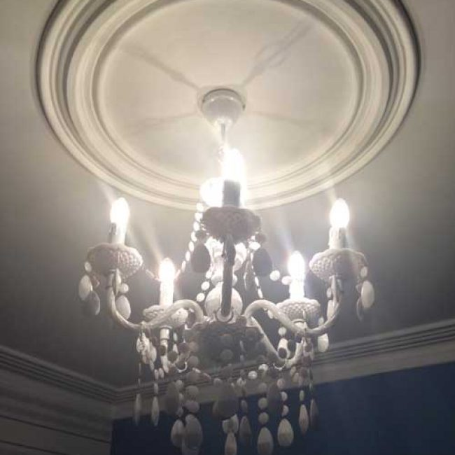 Zeta Candle LED Lamp in chandelier